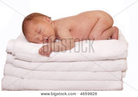 Baby Sleeping On Towels