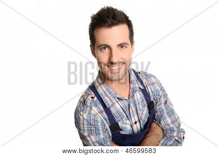 Cheerful craftsman standing on white background