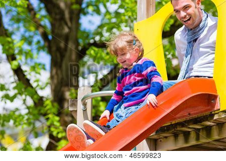 Family - Father and daughter playing on a jungle gym