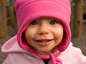 1 Year Old Girl In Bright Pink Hat