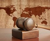 image of magistrate  - Wooden gavel on a background map of the world - JPG