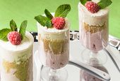 stock photo of curd  - Dessert with raspberry and curd mousse with mint leaves - JPG