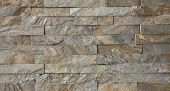 stock photo of tile cladding  - Natural stone granite pieces tiles for walls - JPG