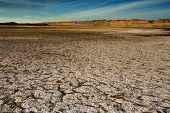 stock photo of mountain-range  - wide angle vista of a dry lake bed in the california desert - JPG