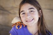 stock photo of hermit  - Young Pretty Girl Playing with Toy Hermit Crab - JPG