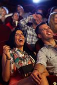 foto of comedy  - Happy couple watching comedy in movie theater - JPG