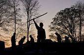 stock photo of boy scouts  - Boy Scouts working on hill at sunset - JPG