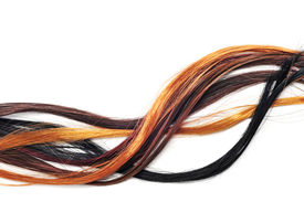 pic of auburn  - hair extensions of different colors on a white background - JPG