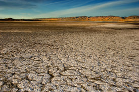 image of mountain-range  - wide angle vista of a dry lake bed in the california desert - JPG