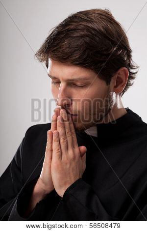 Vicar Praying Earnestly