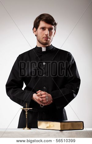 Handsome Reverend With Crucifix And The Bible