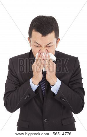 Sick Young Businessman Is Sneezing With Toilet Paper
