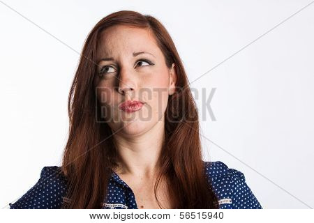 Puzzled Red Haired Woman
