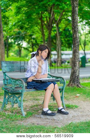 Cute Thai Schoolgirl Is Studying And Imagine Something On A Bench