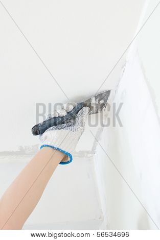 Hand Repairs Gypsum Plasterboard Frame With Spackling Paste