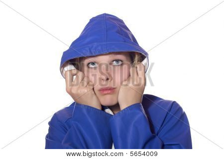 Women In Blue Rain Coat Looking Pessimistic