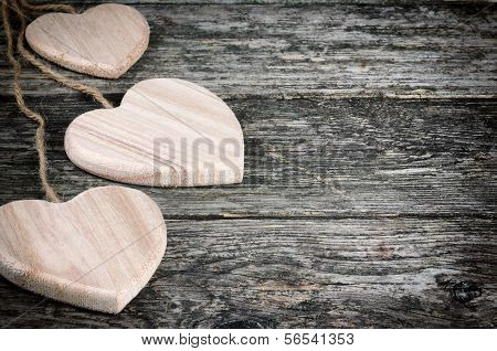 Rustic Hearts On Old Wood Background