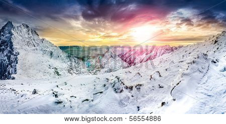 Panoramic View Of White Winter Mountains At Colorful Sunset