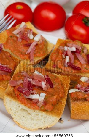 bread with tomatoes and jamon close up