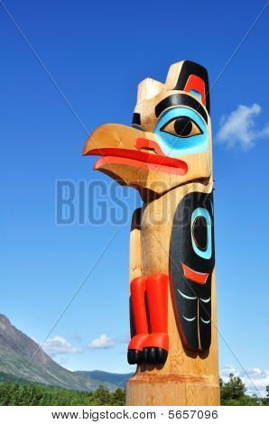 Eagle Totem Pole Against A Blue Sky