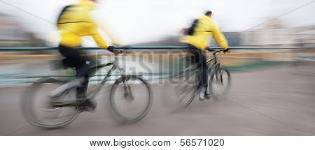 Cyclists On The City Roadway