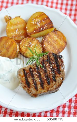 A juicy steak with potato wedges