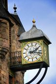 stock photo of mile  - Clock on a building on Royal Mile in Edinburgh - JPG