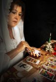 image of fortune-teller  - Woman guesses by means of cards Tarot - JPG
