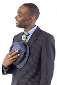 picture of courtesy  - young black businessman being polite by taking hat off - JPG
