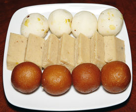 foto of mishti  - indian freah and hot sweets in white plate - JPG