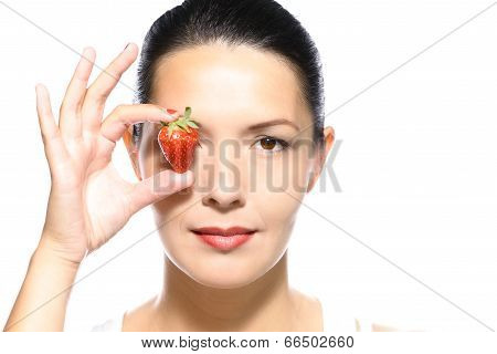 Beautiful Woman With A Ripe Strawberry