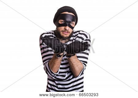 Sad criminal with handcuffs