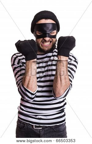 Angry robber with handcuffs