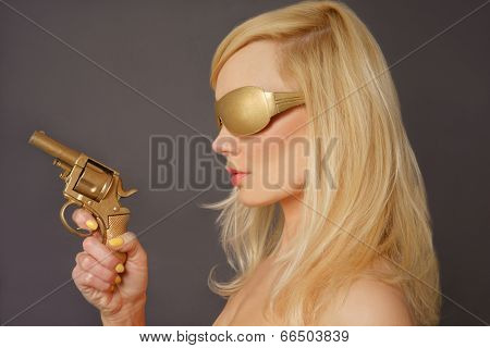 Side view of a Blonde Lady Holding a Golden Gun.