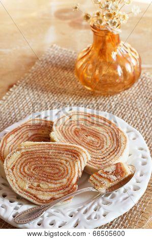 Bolo De Rolo (swiss Roll, Rollcake)  Brazilian Dessert On White Plate