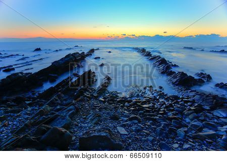 Sunrise over the cretaceous sedimentary rock coast