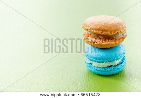 Colorful Macaroons On Green Background.