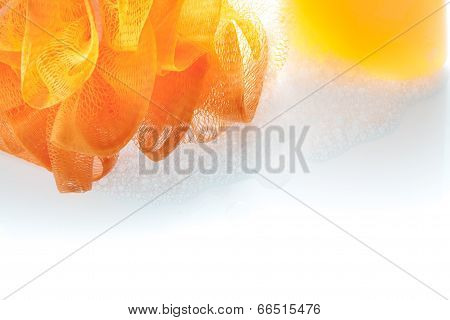 Orange Fiber Scrub And Shower Gel Bottle With Bubble On White Background.