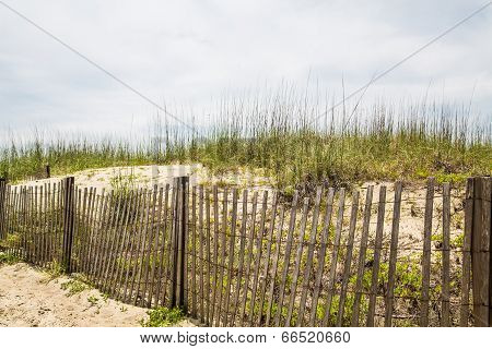 Wood Fence And Sand Dunes