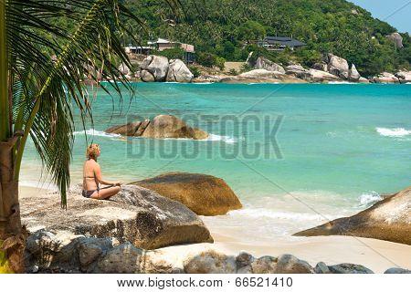 Meditation yoga girl at Coral Cove beach at Koh Samui Island Thailand