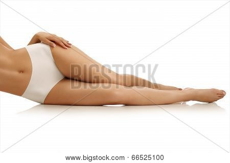 Closeup Of A  Girl Lying On The Floor Showing Beautiful Legs