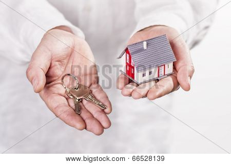 Hands With House And Key