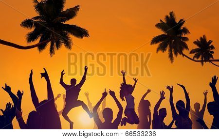 Silhouettes of Young People Partying on a Beach