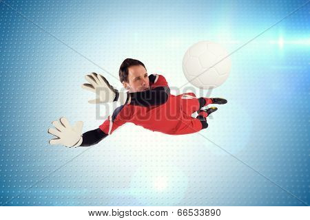 Fit goal keeper jumping up against technical screen with pixels