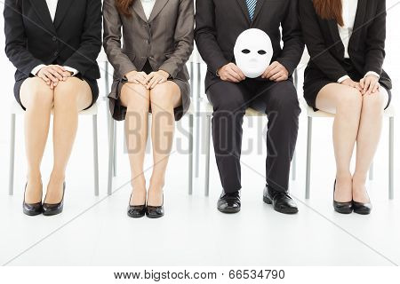 Business People Waiting For Job Interview With A Strange Mask