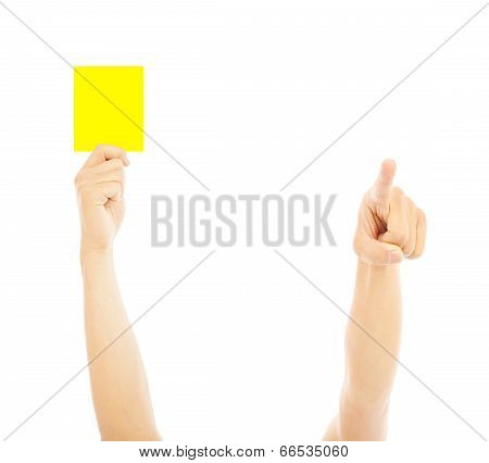 Hand Of Referee With Yellow Card To Warn