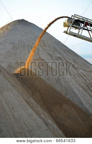 Pouring material into a Pile