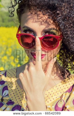 young beautiful girl in sun glasses