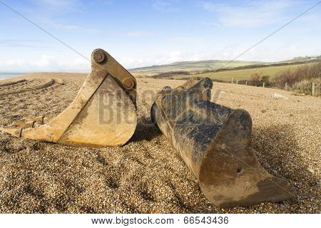 Digger Scoops Left On Pebbled Beach