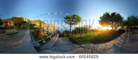 Panorama of the garden with trees and walk ways near the city of Manarola, Itali